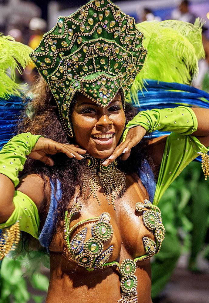 Brazil, State of Rio de Janeiro, City of Rio de Janeiro, Samba Dancer in the Carnival Parade.