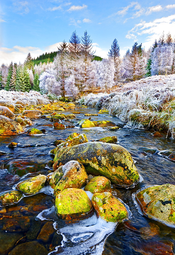 A winter view of the flowing water and colourful rocks of the River Polloch in the Ardnamurchan Peninsula, Scottish Highlands, Scotland, United Kingdom, Europe