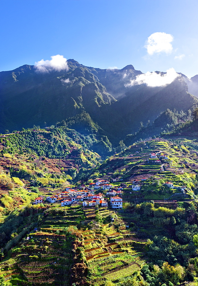 Elevated view of village and tree covered hills and mountains near Ponta Delgada, Madeira, Portugal, Atlantic, Europe