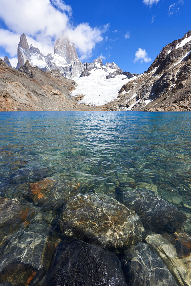 Stones seen through the water of Lago de los Tres featuring Monte Fitz Roy in the background, Patagonia, Argentina, South America