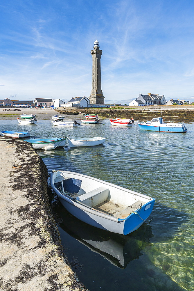 Lighthouse with pier and boats. Penmarch, Finistère, Brittany, France.