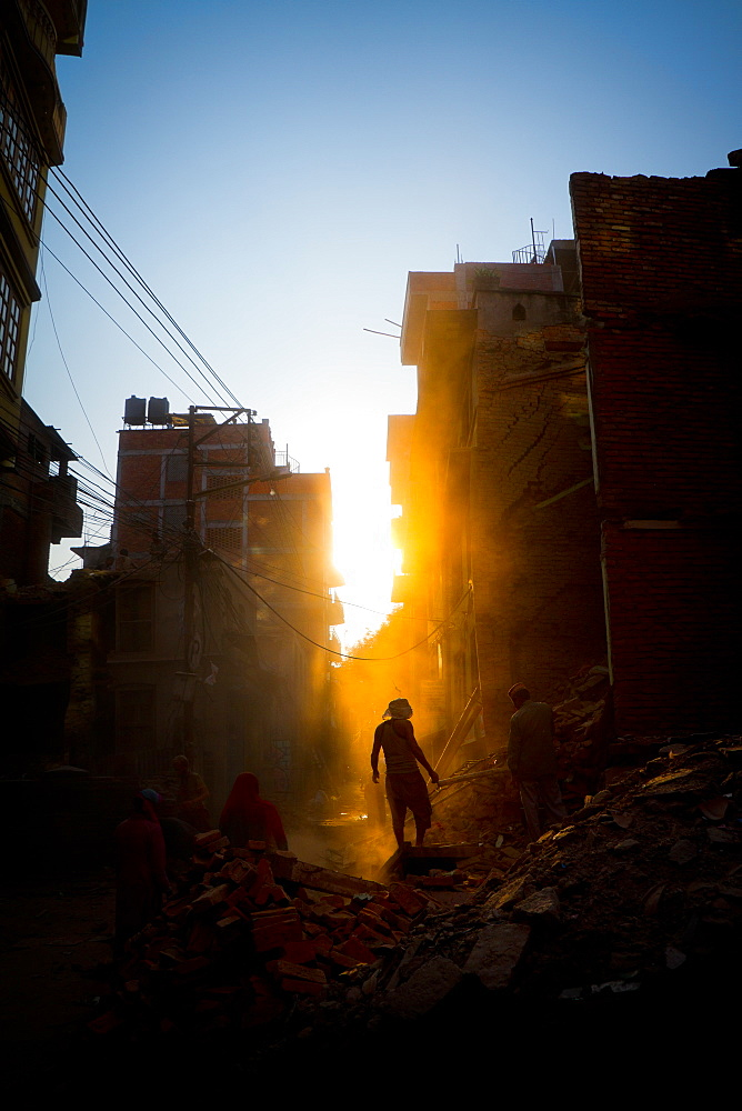 Rays of early evening sun on the dusty streets of Thamel after earthquake, Kathmandu, Nepal, Asia