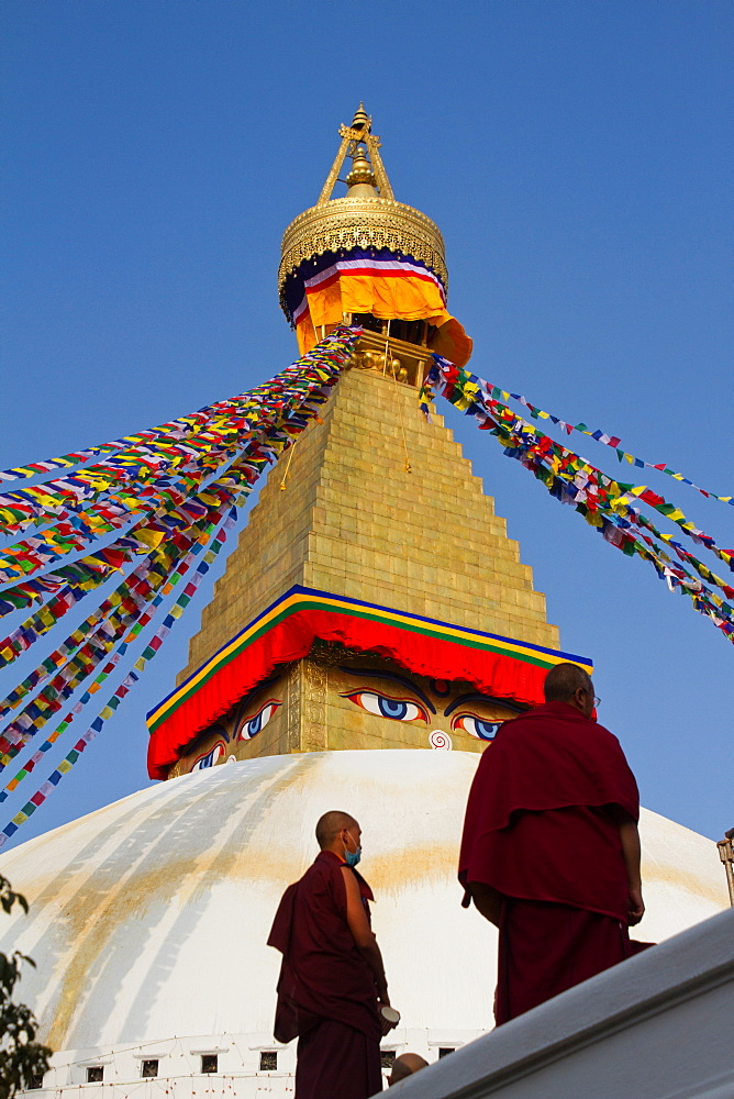 Tibetan Buddhist monks and Boudhanath Stupa, UNESCO World Heritage Site, Kathmandu, Nepal, Asia