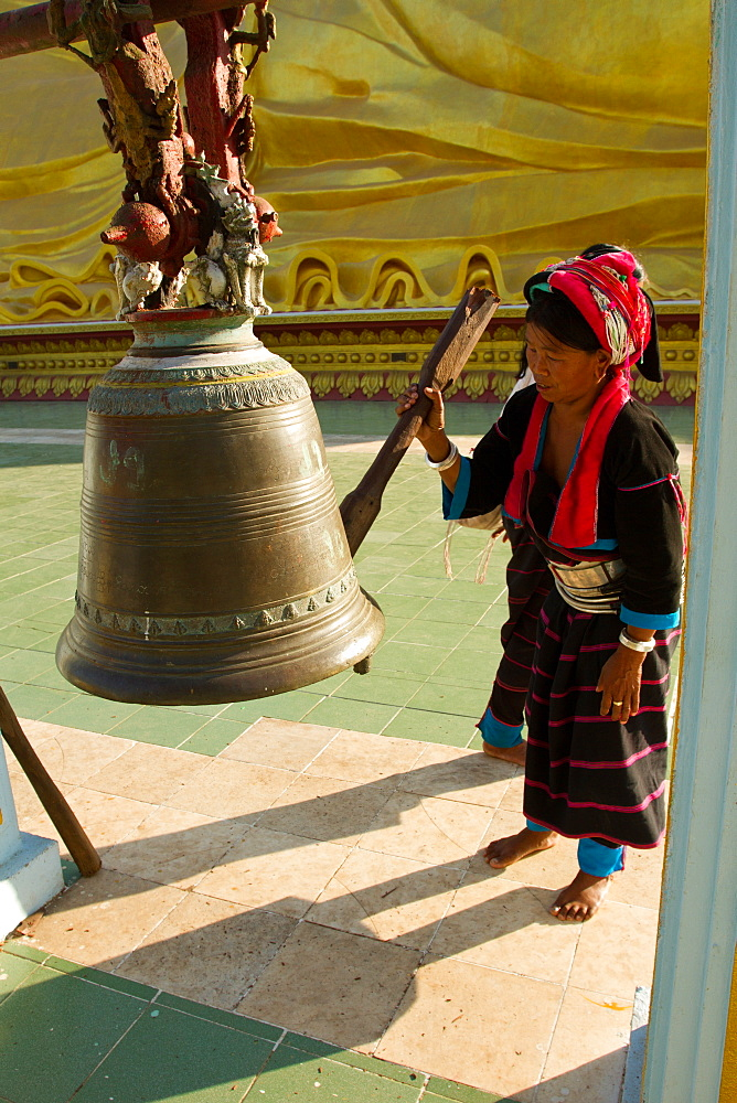 Buddhist bell and devotee, Bagan (Pagan), Myanmar (Burma), Asia