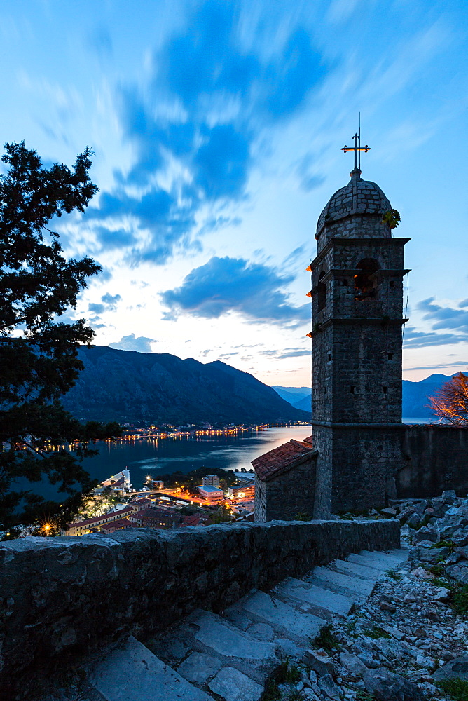 Part of the fortress walls and path above the old town of Kotor during the evening blue hour.