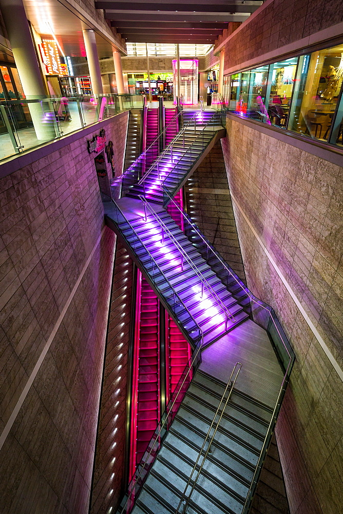 An illuminated staircase in the Liverpool One shopping centre during the evening, Liverpool, Merseyside, England, United Kingdom, Europe