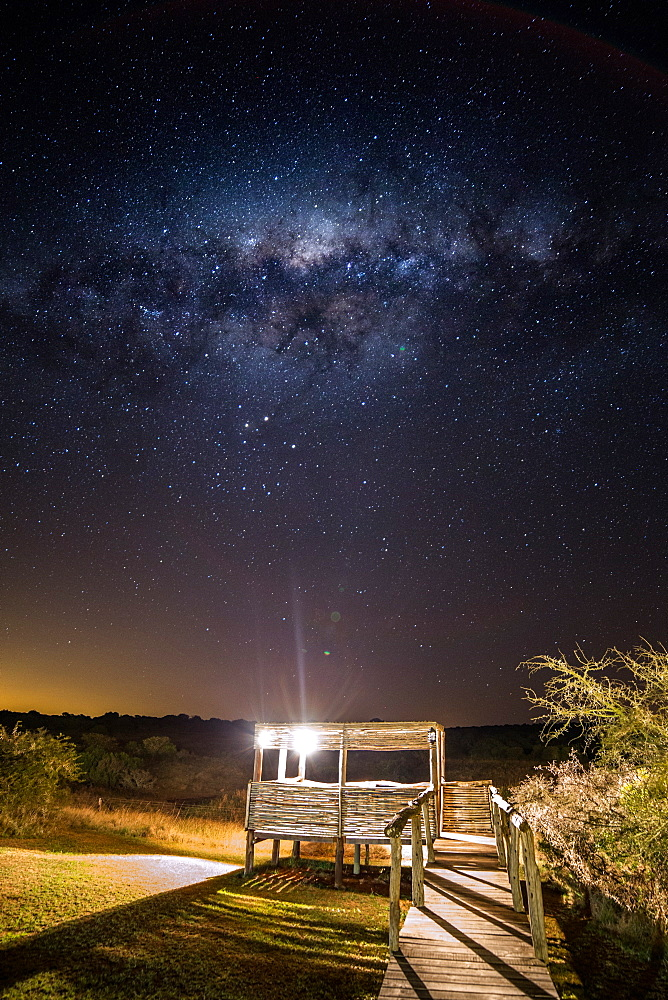 The Milky Way over a viewing platform at the Hlosi Game Lodge in the Amakhala Game Reserve in the Eastern Cape, South Africa, Africa