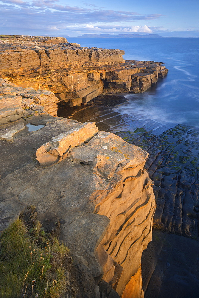 Limestone cliffs lit by low angled evening light on the Wild Atlantic Way at Muckross Head, County Donegal, Ulster, Republic of Ireland, Europe - 1266-42