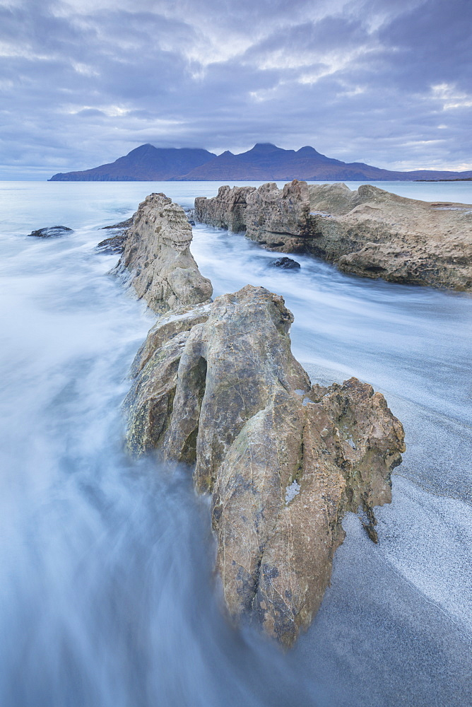 The Isle of Rum from Singing Sands on the Isle of Eigg, Small Isles, Inner Hebrides, Scottish Highlands, Scotland, United Kingdom, Europe - 1266-55