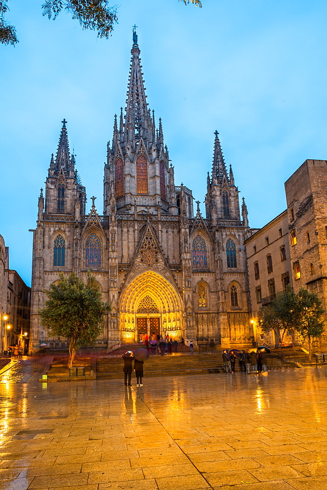 The Cathedral of the Holy Cross and Saint Eulalia at dusk and in the rain, Barcelona, Catalonia, Spain.