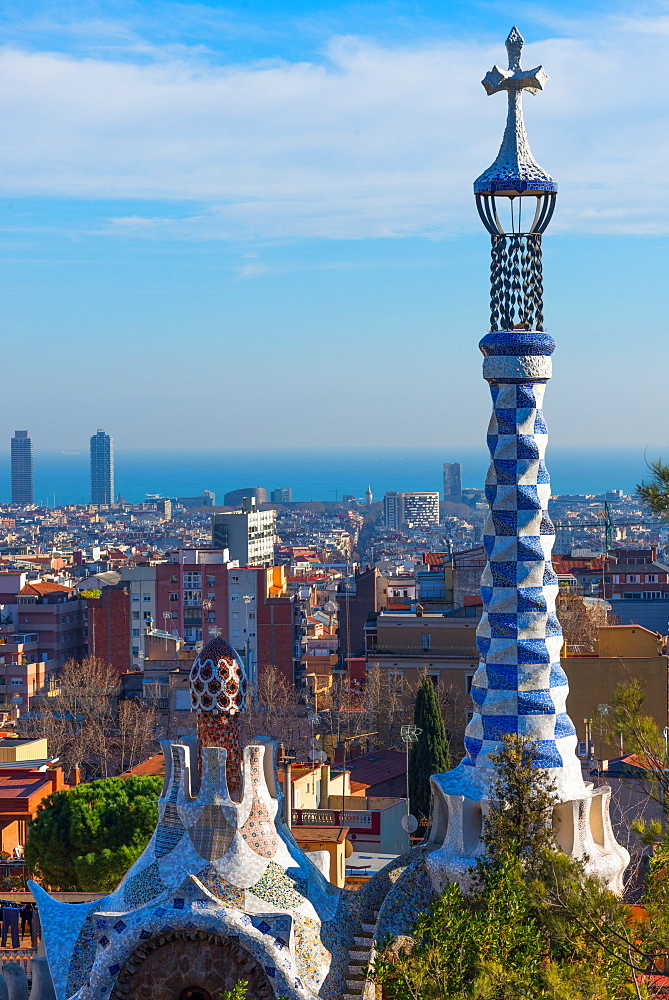 Park Guell houses at Park Guell with views over the city to the sea, by architect Antoni Gaudi. Barcelona, Catalonia, Spain.