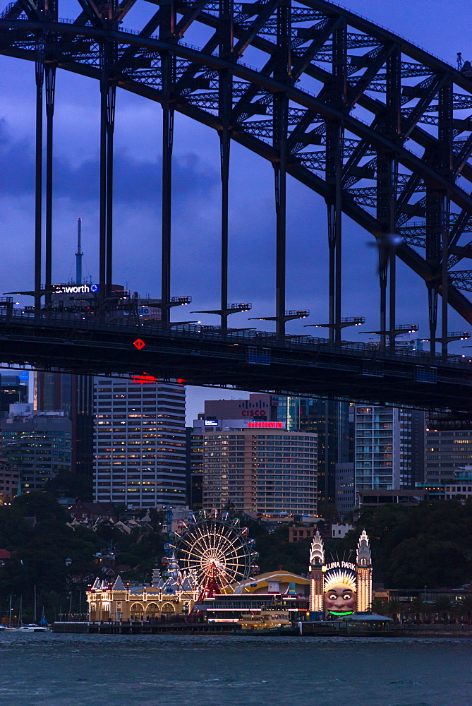 Sydney Harbour brdge with Luna Park amusement park on North shore. Sydney, New South Wales, Australia