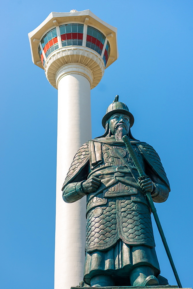 Busan Tower and statue of Admiral Yi Sun-shin at Yongdusan Park, Busan, South Korea.