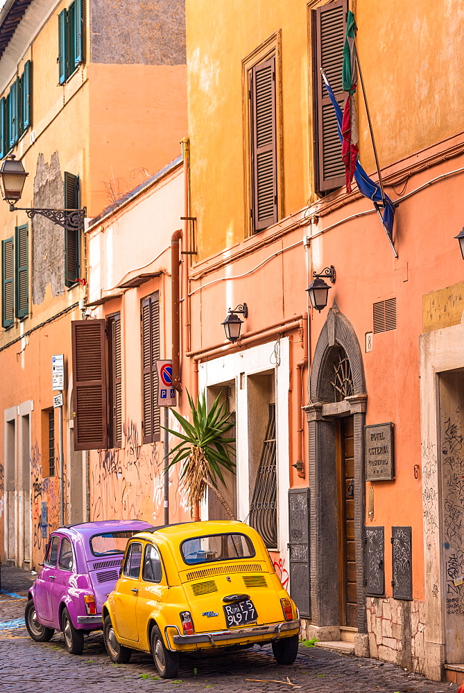 Two vintage Fiat 500s with Roma number plates parked in colourful backstreet of Trastevere, Lazio, Italy, Europe - 1267-247