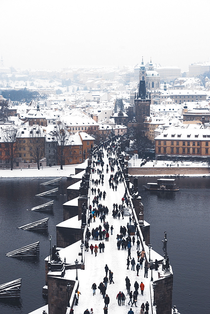 Charles Bridge over the Vltava River in winter, UNESCO World Heritage Site, Prague, Czech Republic, Europe