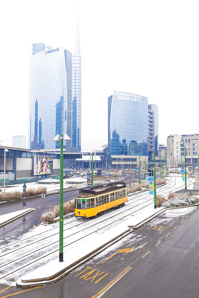 Traditional tram transit in front of skyscapers of Porta Garibaldi, Milan, Lombardy, Northern Italy, Italy, Europe - 1269-98