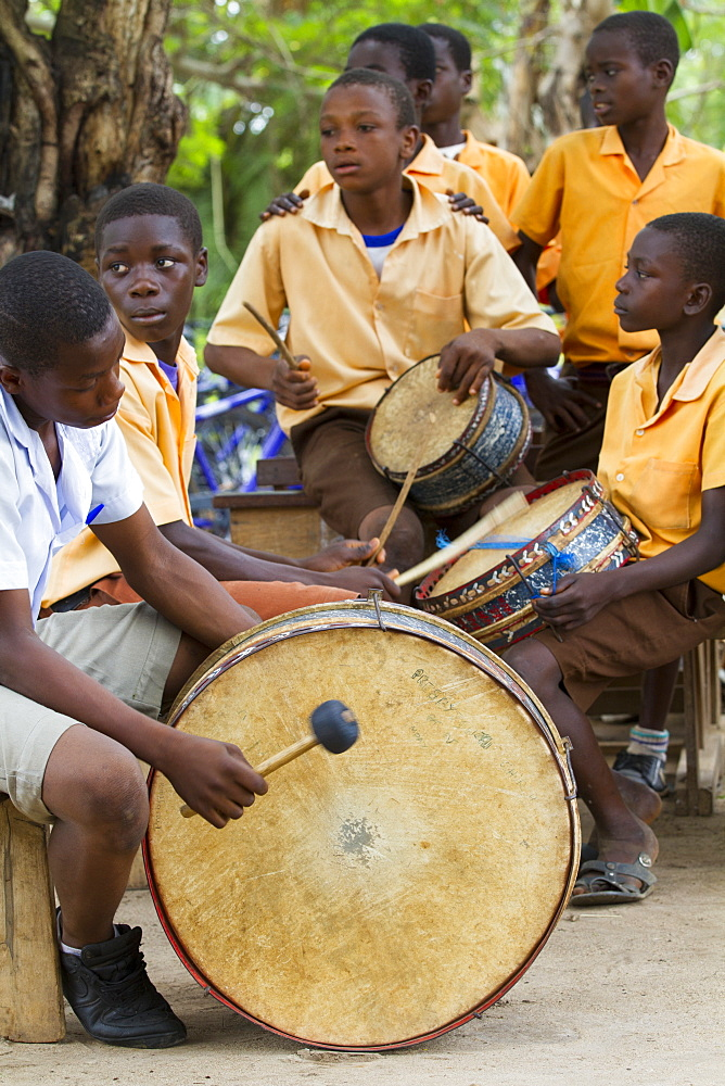 A group of young men playing the drums in Ghana.