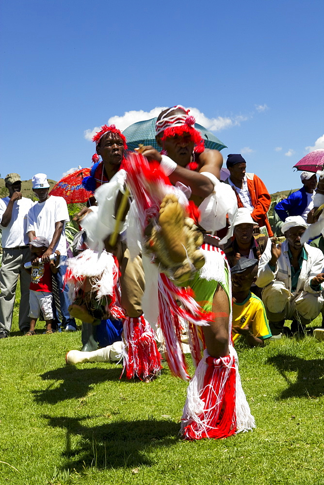 Traditional dancers entertain the crowds at one of Send a Cow's passing on ceremonies, Lesotho, Africa