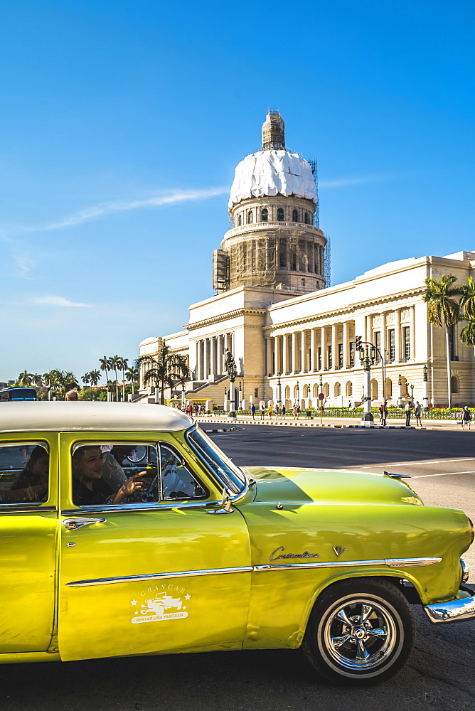 A green American car outside El Capitolio in Havana, La Habana, Cuba, West Indies, Caribbean, Central America