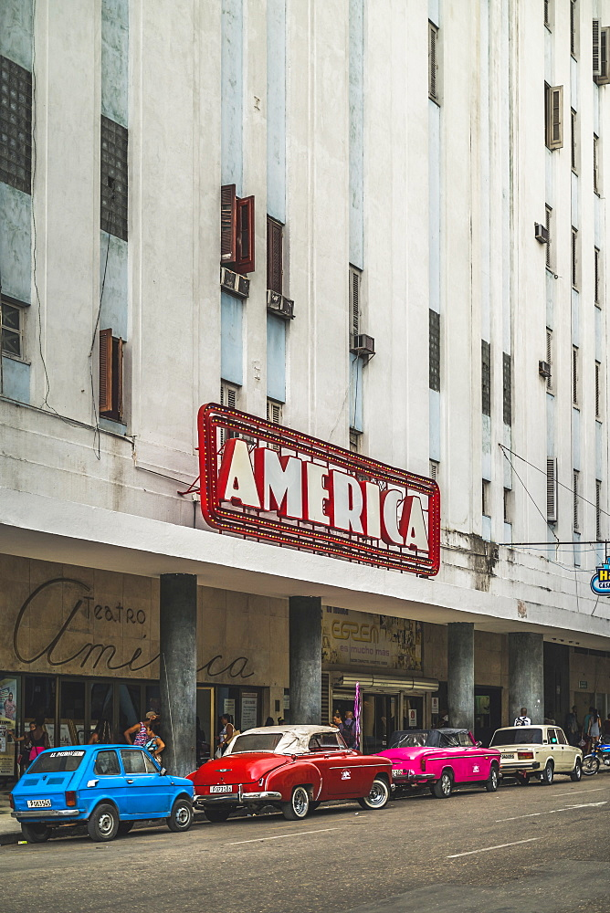 Old vintage cars parked outside Teatro America, La Habana (Havana), Cuba, West Indies, Caribbean, Central America