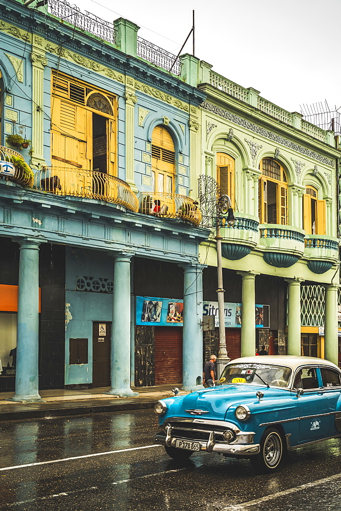 Turquoise vintage taxi in the rain, La Habana, Havana, Cuba, West Indies, Caribbean, Central America