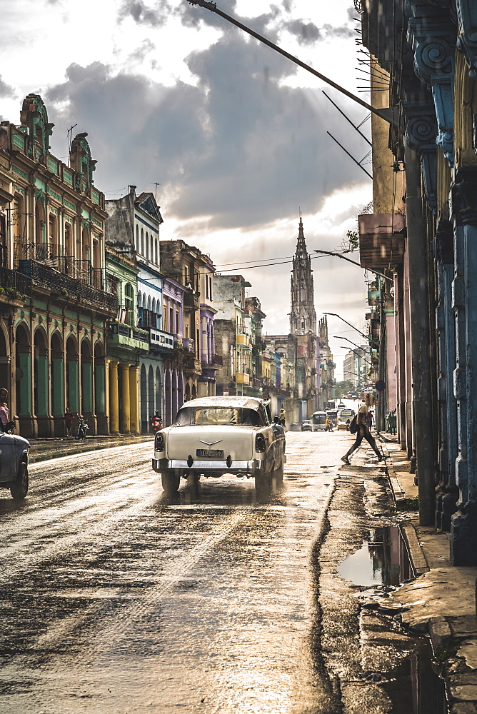Typical street in La Habana and cathedral in the distance in rain, Havana, Cuba, West Indies, Caribbean, Central America