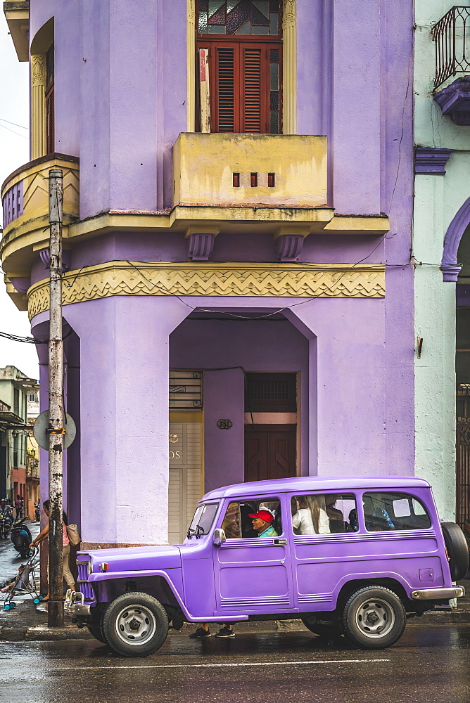 Pink building and pink vintage car in La Habana, Havana, Cuba, West Indies, Caribbean, Central America