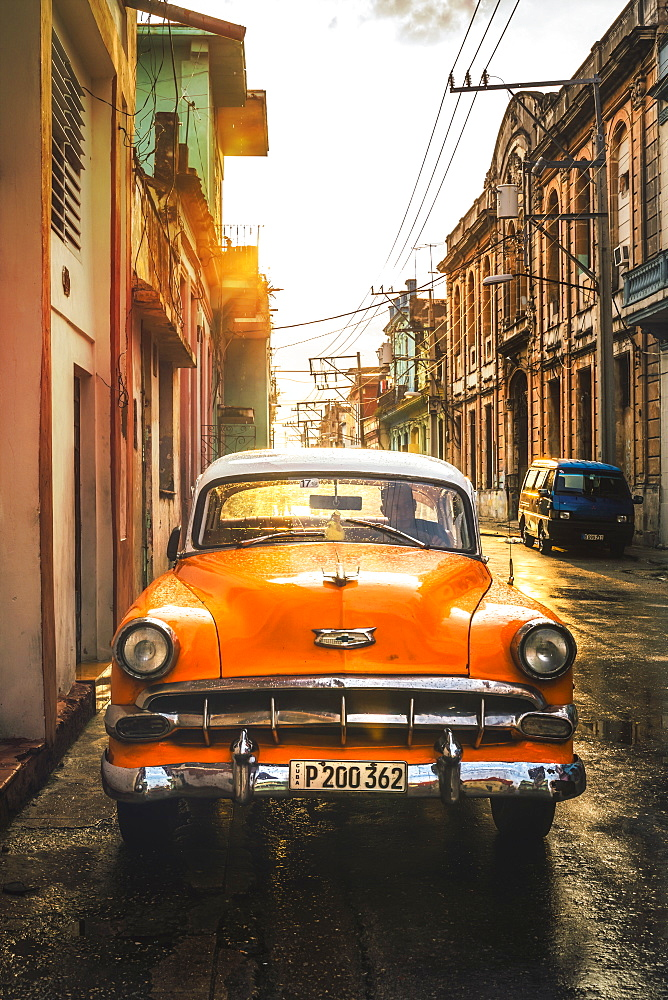 Orange American vintage car at sunset, La Habana (Havana), Cuba, West Indies, Caribbean, Central America