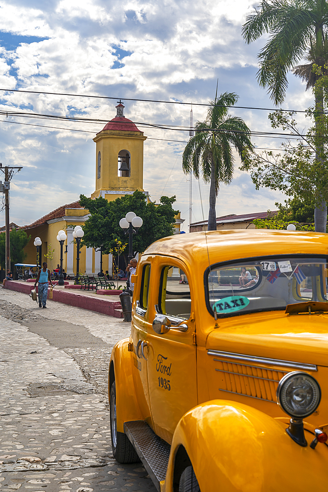 Yellow vintage taxi in Trinidad, UNESCO World Heritage Site, Trinidad, Cuba, West Indies, Caribbean, Central America