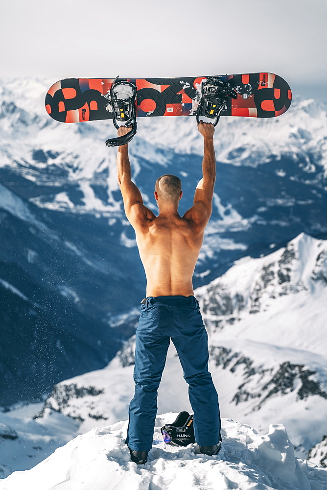 Snowboarder on top of Glacier at La Plagne ski resort, Tarentaise, Savoy, French Alps, France, Europe