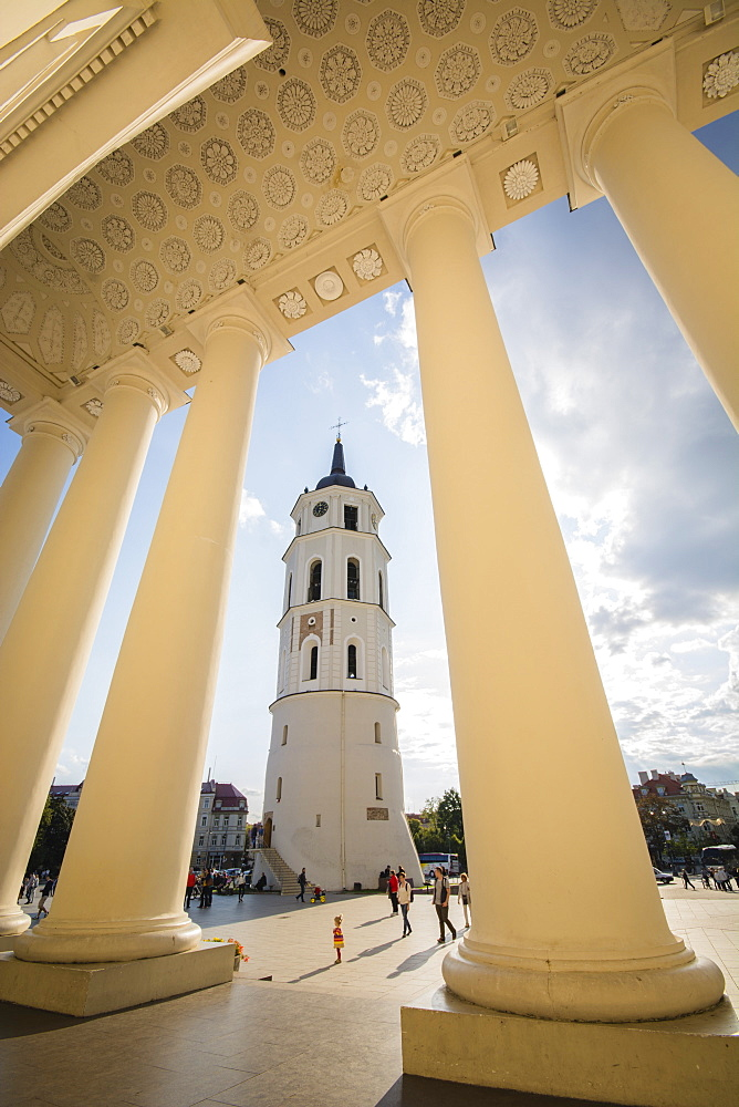 People and child walking in Cathedral Square Plaza beside the Bell Tower in Vilnius, Lithuania, Europe - 1281-2