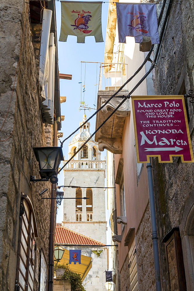 Narrow street in the old town of Korcula Town with view to the Saint Mark's cathedral