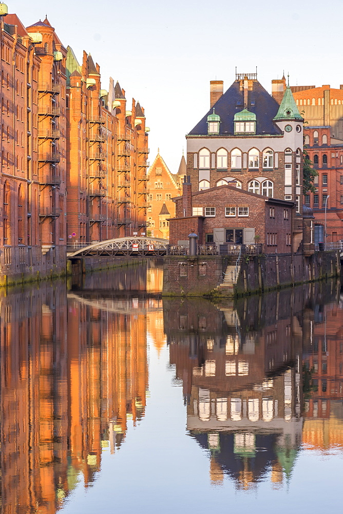 Wasserschloss building at the historical warehouse complex (called Speicherstadt) seen from Poggenmuehlenbruecke at sunrise