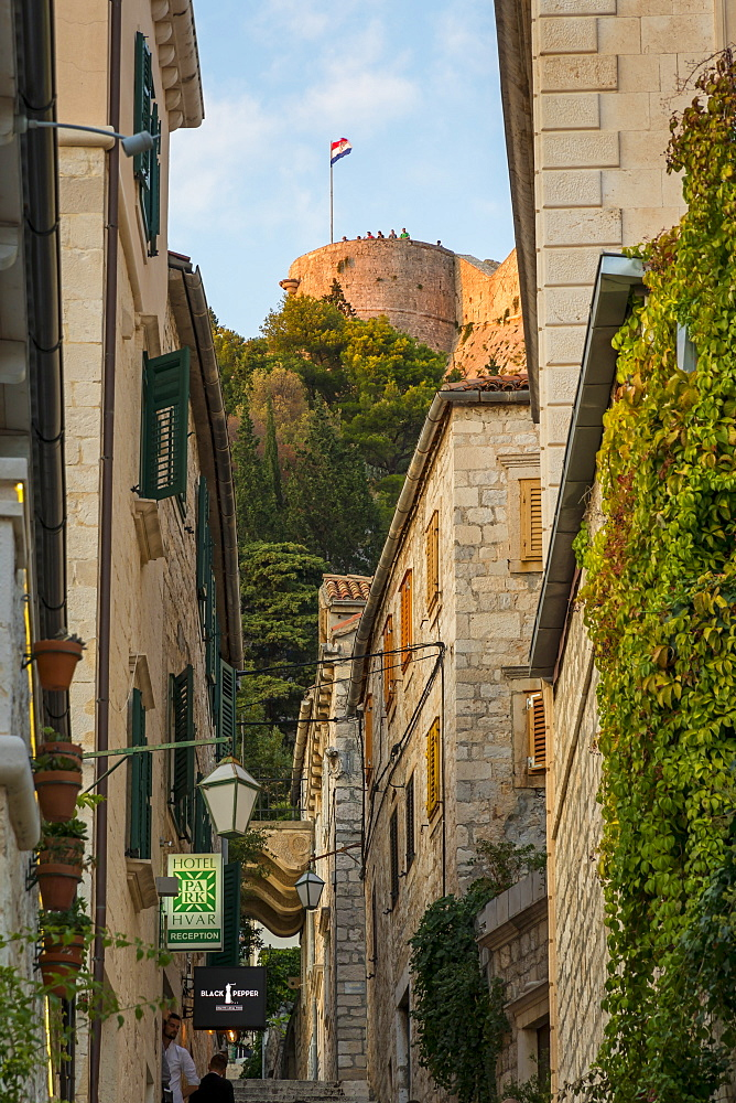 View from the old town of Hvar to the Spanish Fortress at sunset, Hvar, Croatia, Europe