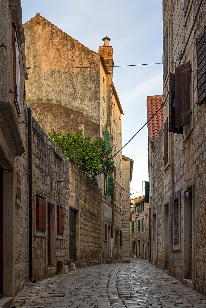 Narrow street in the old town of Stari Grad on Hvar Island at first sunlight, Hvar, Croatia, Europe