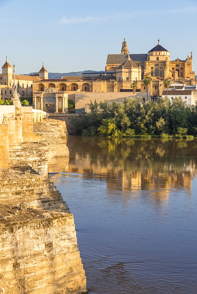 The Mosque-Cathedral (Great Mosque of Cordoba) (Mezquita) and the Roman bridge at first sunlight, UNESCO World Heritage Site, Cordoba, Andalusia, Spain, Europe
