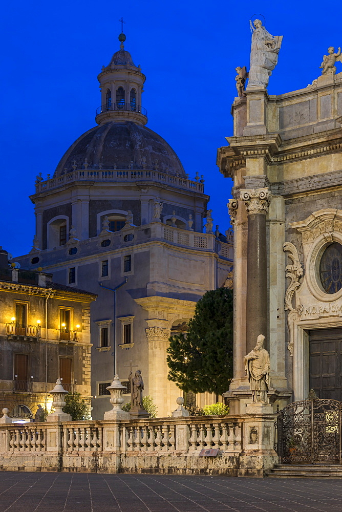 The illuminated cathedral and Saint Agatha Abbey during blue hour, Catania, Sicily, Italy, Europe