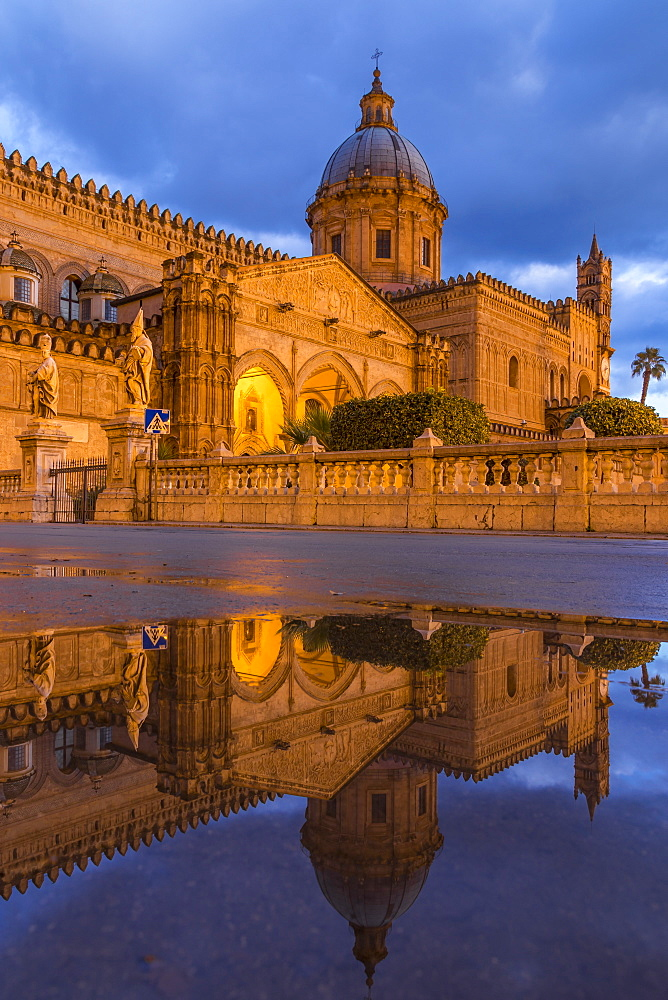 The illuminated Palermo Cathedral (UNESCO World Heritage Site) reflected in a puddle, Palermo, Sicily, Italy, Europe - 1283-756