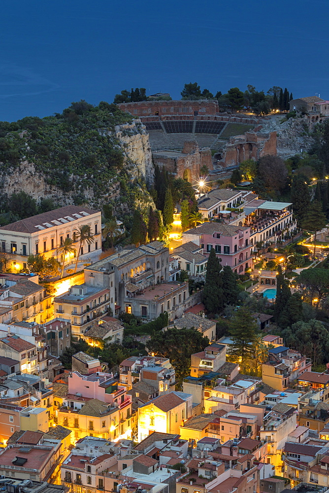 View down to the city centre and the ancient Greek Theatre at dusk, Taormina, Sicily, Italy, Europe - 1283-804