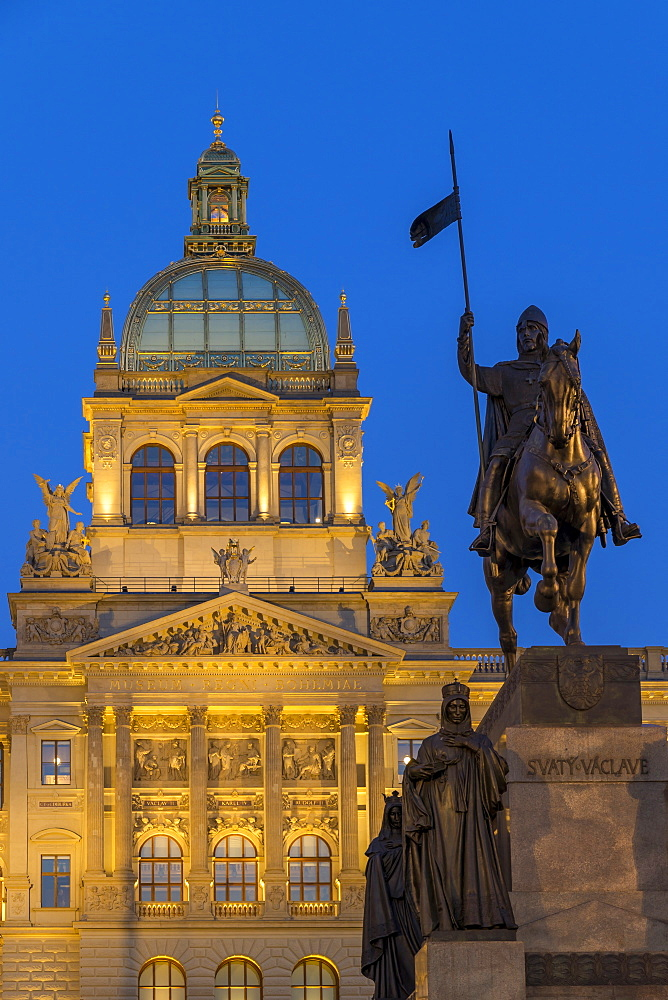 The illuminated National Museum (Narodni Muzeum) and the statue of St. Wenceslas at dusk, Prague, Bohemia, Czech Republic