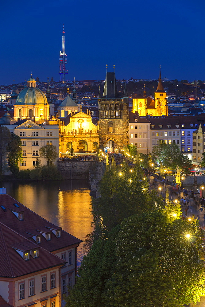 View from the Lesser Town Bridge Tower over Charles Bridge and the old town at dusk, UNESCO World Heritage Site, Prague, Bohemia, Czech Republic, Europe