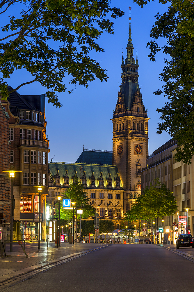Illuminated town hall seen from Moenckebergstrasse at dusk, Hamburg, Germany, Europe