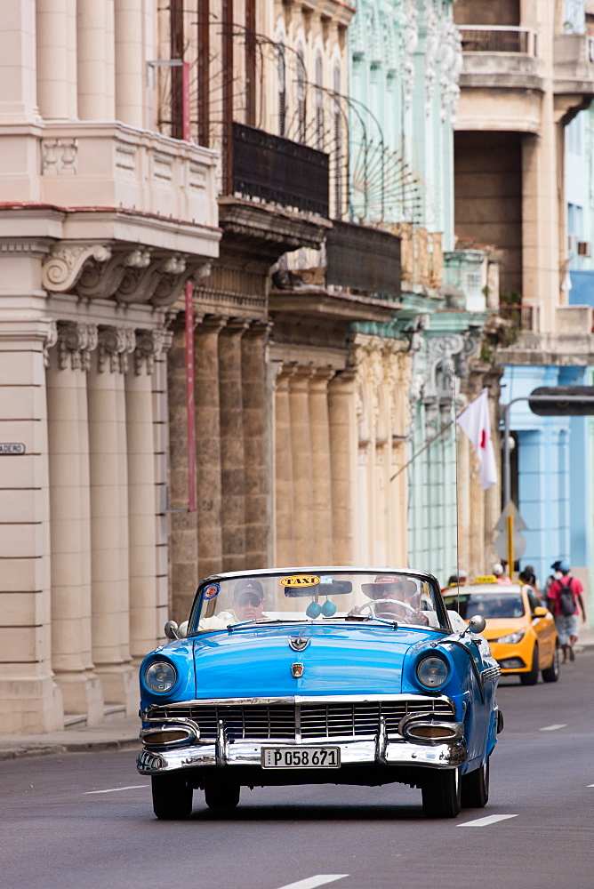 Blue convertible vintage taxi driving along Paseo de Marti in Havana, Cuba, West Indies, Caribbean, Central America