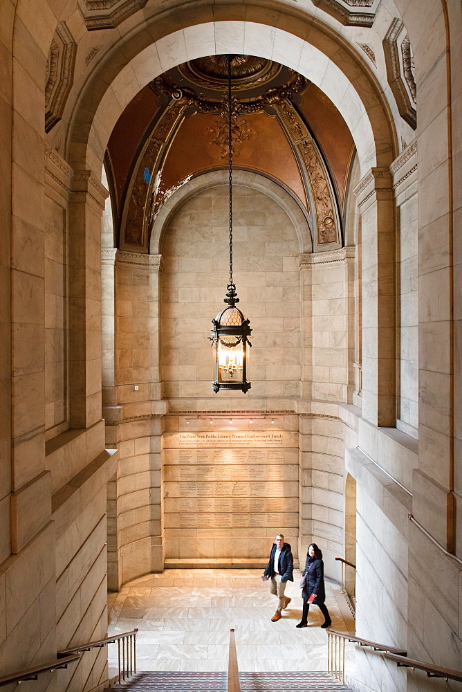 Two people walking up a staircase, New York Public Library, New York City, New York, United States of America