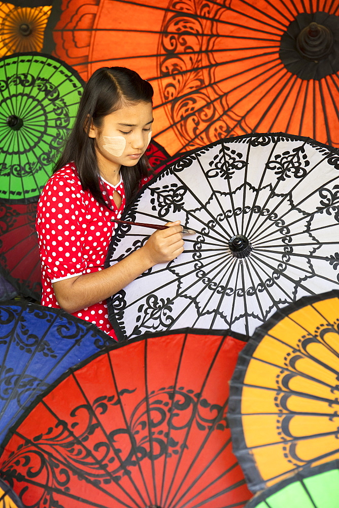 Young lady decorates colourful parasols in Bagan, Myanmar (Burma) - 1284-30