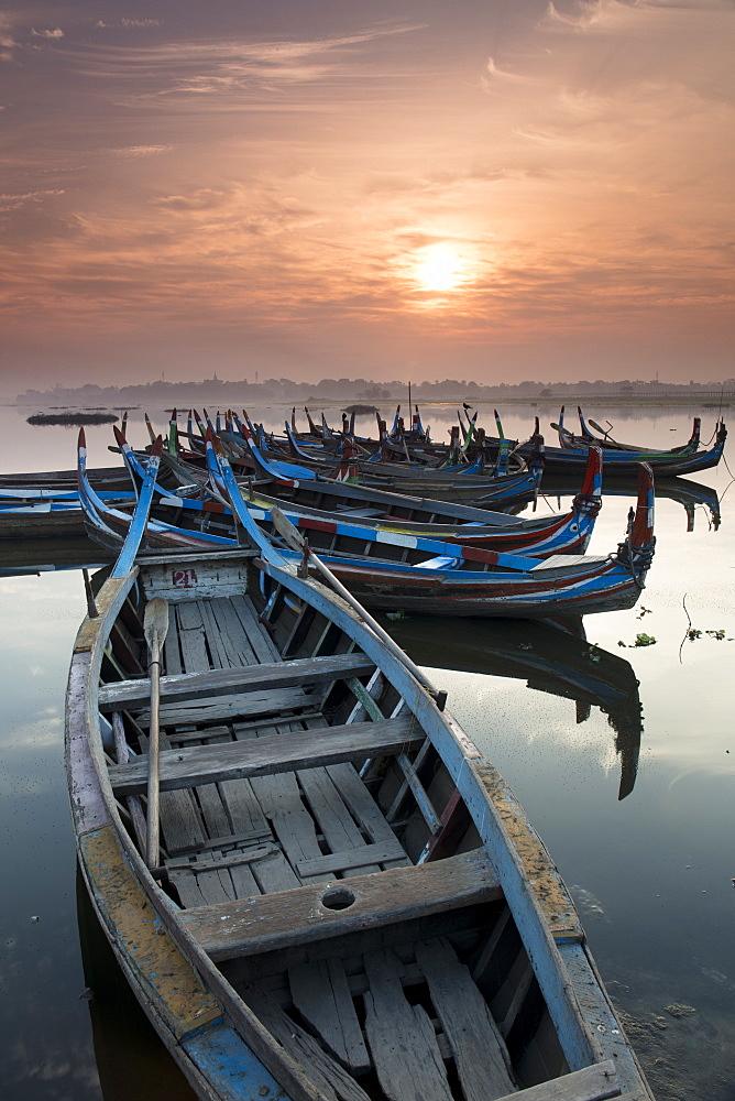Fishing boats at sunrise on lake Taungthaman near Amarapura, Myanmar (Burma)