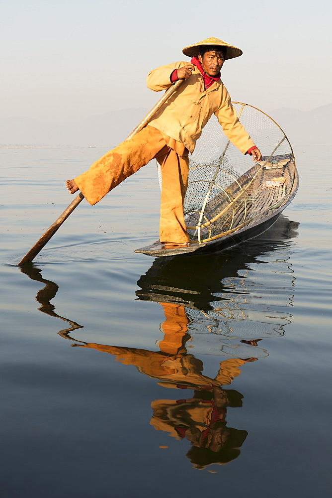 A fisherman rowing with one leg on Inle Lake, Shan State, Myanmar (Burma), Asia