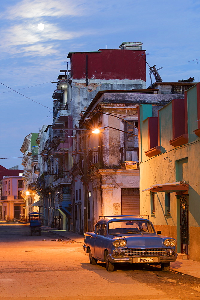 A blue vintage American car parked on a street in the early morning in Havana, Cuba, West Indies, Caribbean, Central America