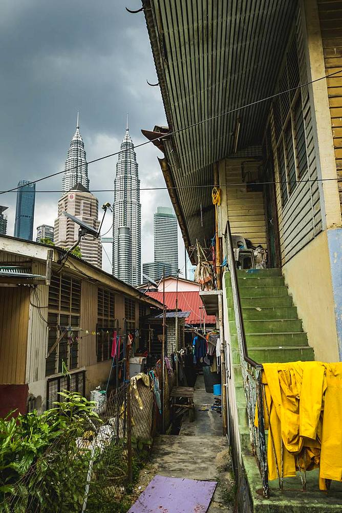 Alley in Kampung Baru with the Petronas Twin Towers in the background, Kuala Lumpur, Malaysia, Southeast Asia, Asia