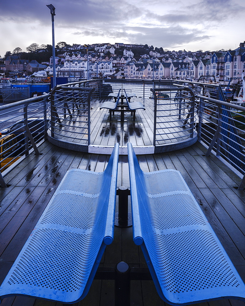 Wet teak decking and benches of the elevated nautical viewpoint for the harbour of Brixham, Devon, England, United Kingdom, Europe - 1295-62